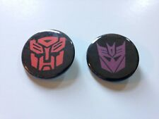 Set of 2 Transformers Autobot Decepticons Emblem 80's Cartoon 1.25 in Pin Button