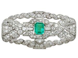 Antique Art Deco 1.98 Ct Emerald and 5.22 Ct Diamond, Platinum Brooch