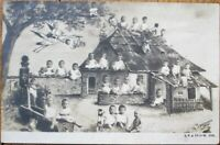 Multiple Baby 1905 Realphoto Postcard: Babies around Cottage - French Fantasy