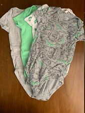 4 piece Carter's 6 month old dinasour themed short- sleeved bodysuits