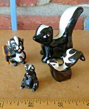 4 Vintage Miniature Skunk Figurines - An Assortment Of Little Stinkers!