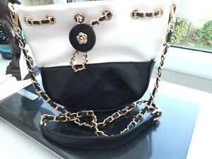 ladies black and white brand new shoulder bag with metal chain strap
