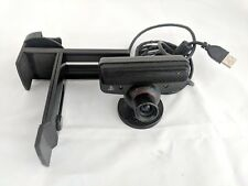 PlayStation 3 PS3 Move Eye Camera with flat screen TV stand.