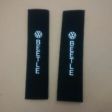 VW Beetle seat belt pads with embroidered logo.