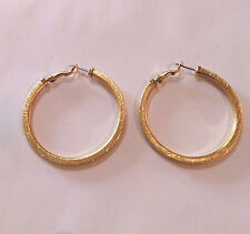 Surgical stainless steel flat sided gold hoop earrings, diameter 6 cm.