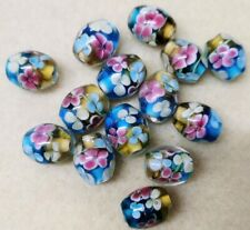 50gm Hand Made Lamp work Beads ~15mm Diametre - Aqua & Amber Base with Flowers
