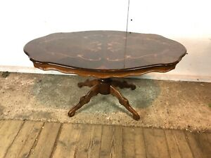 Oval Wooden Coffee Table with Ornate Top and Carved Legs