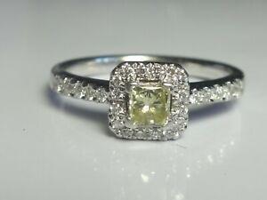 18CT WHITE GOLD 0.50CT LIGHT YELLOW & WHITE DIAMOND HALO CLUSTER RING