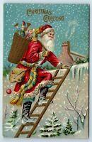 Vintage Postcard Christmas Greetings Santa Claus Basket Of Toys On Rooftop c1907