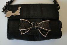 mini sac de soirée en tissus noir brillant avec chaine et noeud doré  Lollipops