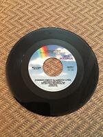 CONWAY TWITTY LORETTA LYNN SILENT PARTNER 45 RPM LOVIN' WHAT YOUR LOVIN' DOES