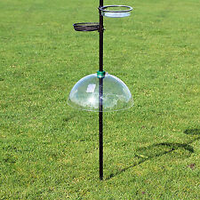 Adjustable plastic squirrel baffle use to prevent vermin stealing bird feed