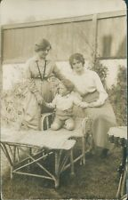 Postcard Family Group 1930's  Wicker Arm Chair Garden unposted