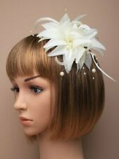 Cream fascinator with petals, feathers and bead detailing (beak clip and pin)