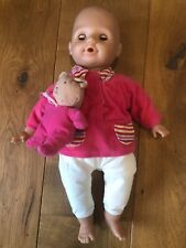 Doll With Blue Eyes And Pink Jumper With Teddy Bear