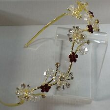 Gold plated Alloy red & clear crystal beaded flowers in a wavy head band tiara