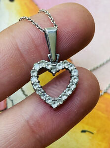 Silver and clear stones/cz heart pendant with silver chain