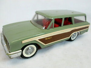Vintage 1960's Buddy L Ford green Country Squire station wagon w/suspension