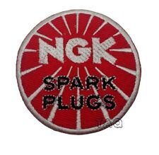 MOTOR RACING OILS, FUELS & TYRES SEW ON / IRON ON PATCH:- NGK SPARK PLUGS DISC a