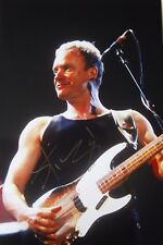 Original hand signed photo of Sting in concert 11.9 x 8 inches by Mel Longhurst