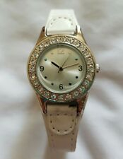 Lady's white leather strap watch with diamanté stones