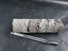 Teaching hand Volcanic igneous basaltic specimen stone aa lavarock volcanic core
