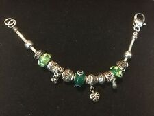 "Pre Owned Silver-like 8"" Bracelet with green charms.  Adorable!"