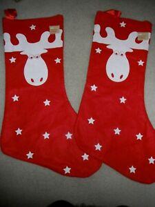 TWO RED KIDS FLEECE CHRISTMAS STOCKINGS