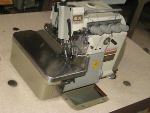 INDUSTRIAL PEGASUS EX3216-42  WITH 3/4/5 THREAD OVER LOCKER SEWING MACHINE.