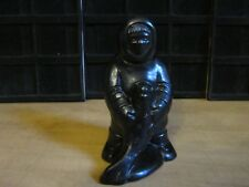 """Aboriginal Inuit Eskimos Clay Carving Man Hugging Seal with both hands-6"""" Height"""