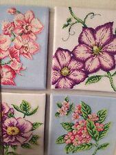 Un cuadro de puntada cruzada Floral Cuarteto