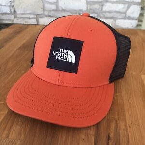 The North Face Mudder Trucker Hat Persian Orange Youth Snapback Cap Box logo