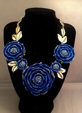 Unsigned OSCAR DE LA RENTA  blue resin flowers and goldtone necklace