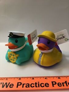 lot of 2 Infantino rubber ducks aqua sea captain purple rain slicker duckie
