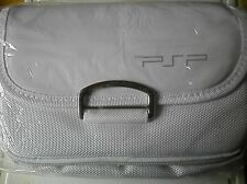 white P S P games consolecarrying case