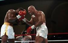 Old Boxing Photo Evander Holyfield Is Hit With A Right Punch From Pinklon Thomas