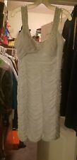 DB Studio. Short, white & beaded wedding dress
