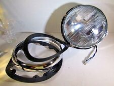 NEW  HEADLAMP ASSEMBLY FOR VINTAGE TR6   IN ORIGINAL WRAPPING