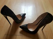 "6.5"" inch extreme high heels in black patent. Euro size 40"