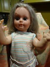 60cm  belle poupée tout d origine ans 60/70  yeux dormeurs verts longs cheveux