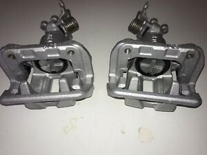 Honda S2000 Pair of rear refurbished Nissin calipers with brackets.