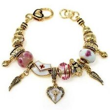 Gold Toned Charm Bracelet With Pink and White Nurse Charms