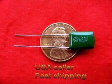 12 pcs  -  .068uf  (0.068uf)  100v  metalized film capacitors (L) grn