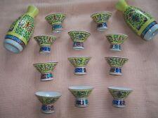 "VINTAGE JAPANESE SAKE JUGS (2) AND MATCHING SET 11 CUPS-5"" TALL JUG 1 1/2"" CUPS"