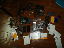 Large lot of old phones, chargers, manuals, ear phones, and other things.