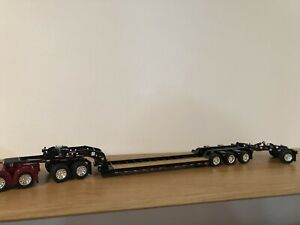 Dcp Fontaine Magnitude Lowboy Trailer W/ Jeep And Stinger Axle Black 1/64