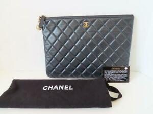 NWOB Chanel Navy Quilted Lambskin/Gold-Tone Metal O Case Pouch/Clutch $1200