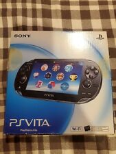 Sony PS Vita Console (PCH-1001) in Box W/ Grip, 3 Games, and 2-16GB Memory Cards