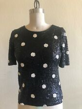 Black with white polka dot sequined knit top. Retro pin up look Size M/L