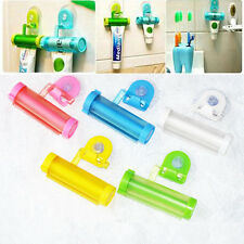 Plastic Rolling Squeezer Toothpaste Dispenser Tube Partner Sucker Hanging Holder